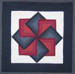 Custom Amish Quilts - Red Navy Spinning Star Small Quilt Wall Hanging