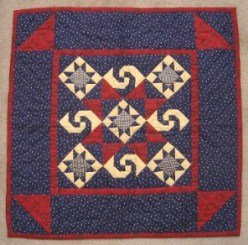 Custom Amish Quilts - Twirling Star Navy Red Small Quilt Wall Hanging