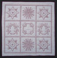 Custom Amish Quilts - Hand Embroidered Red Snowflake Small Quilt Wall Hanging