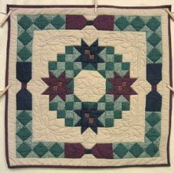 Custom Amish Quilts - Poinsetta Wreath Patchwork Small Quilt Wall Hanging