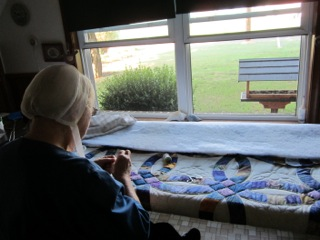 Anna Amish Quilter with Quilt